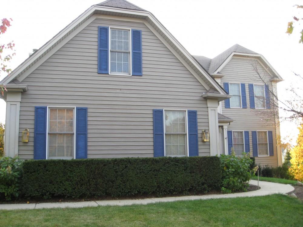 Photo By Erdmann Exterior Designs Ltd.. Complete Exterior Renovation: Elgin, IL