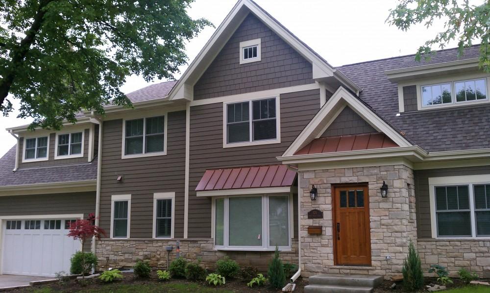 Photo By Erdmann Exterior Designs Ltd.. Custom Home Addition, James Hardie Siding: Arlington Heights, IL