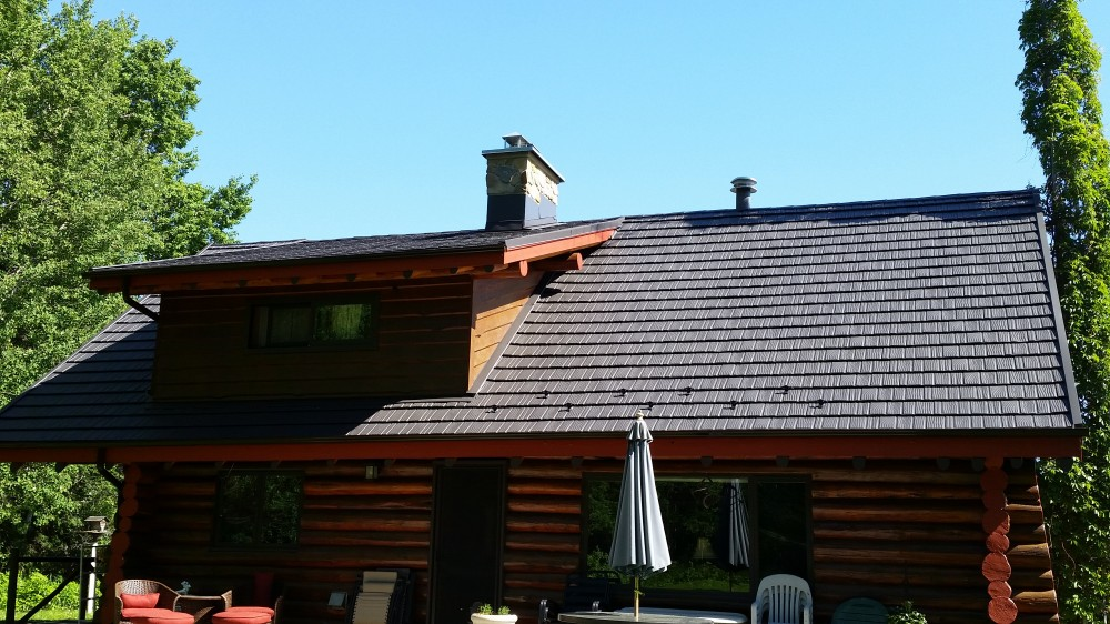 Photo By Renoteck Roofing. Iron Wood Shake