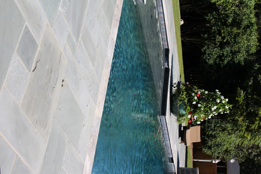 Photo By Brown's Pools & Spas. A Backyard Living Space
