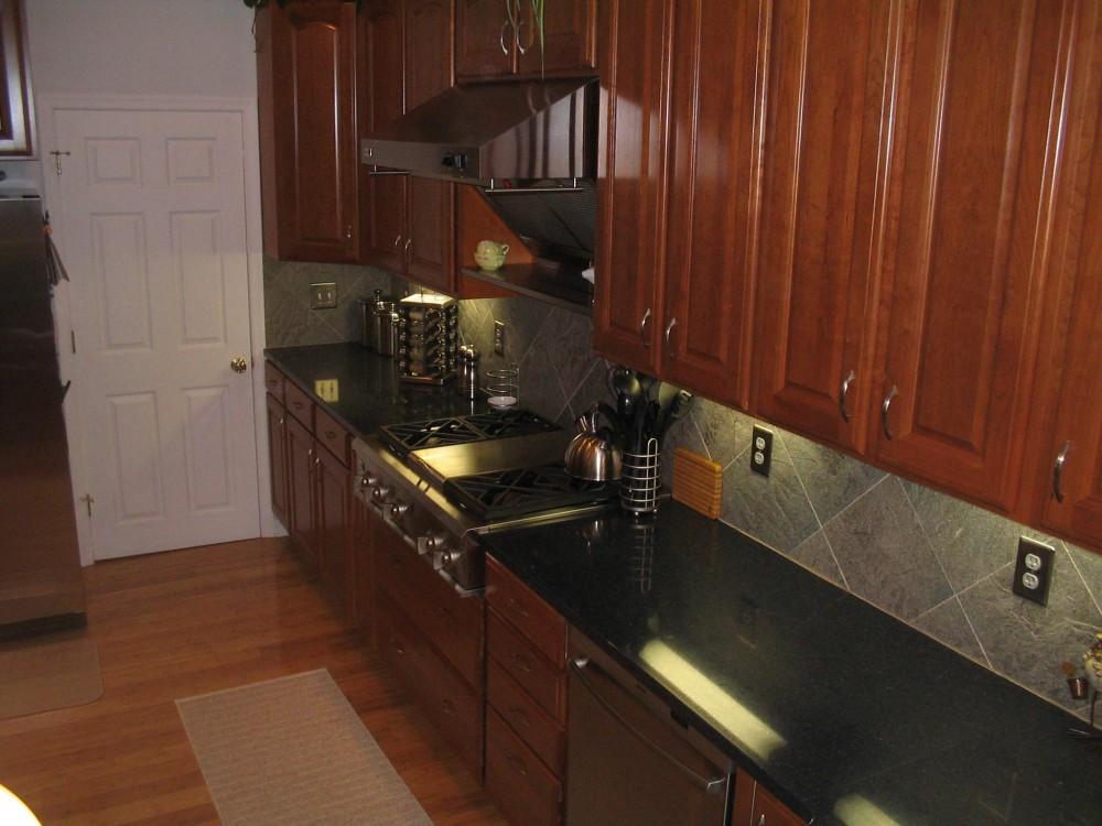 Photo By Starcom Design Build. Kitchens