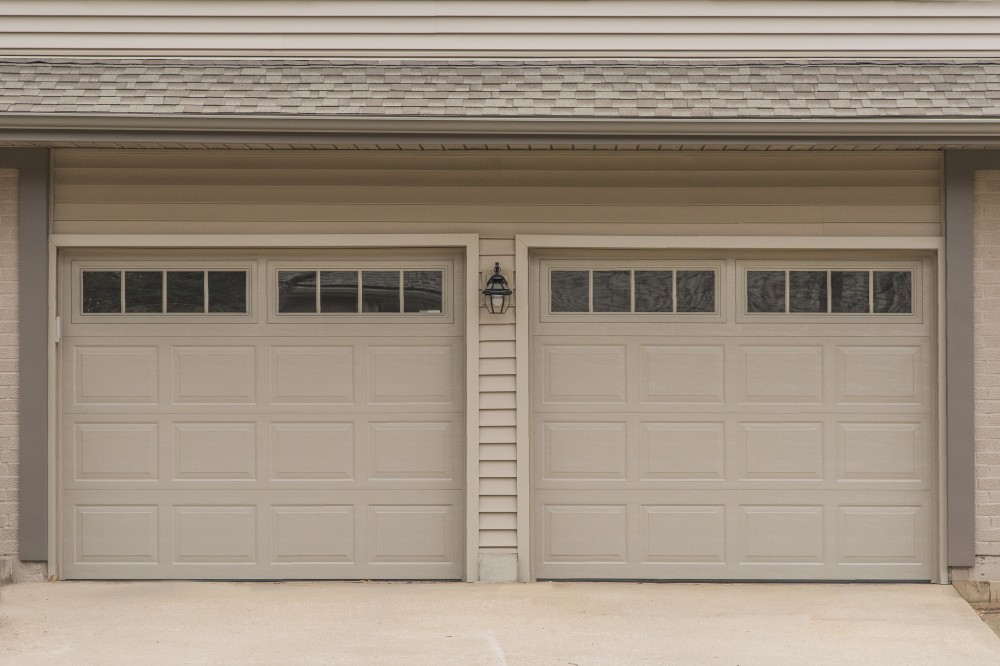 Photo By Johnson County Siding & Window Co.. Carriage Garage Doors