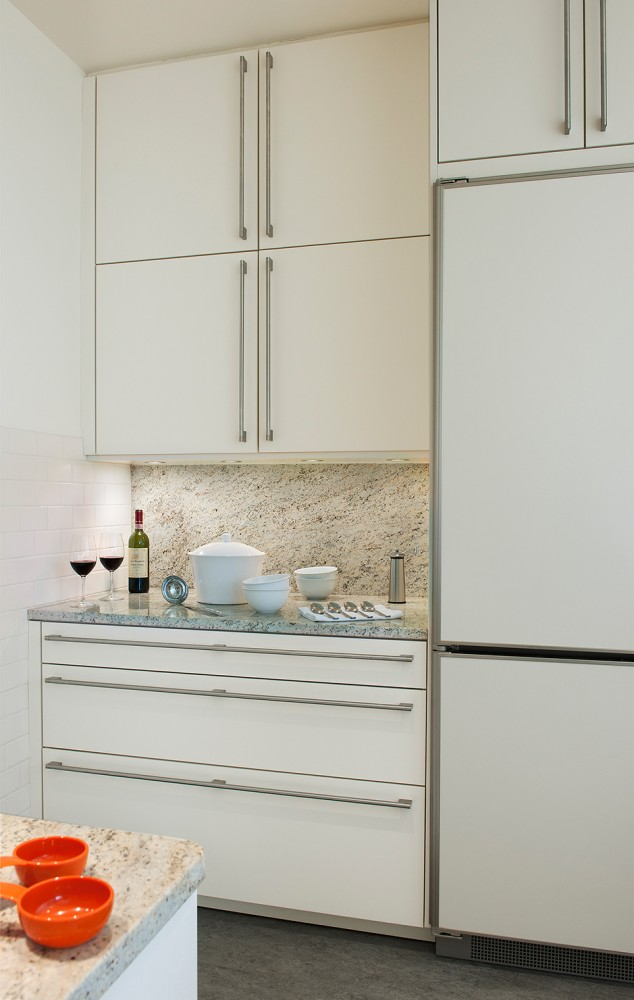 Photo By CARNEMARK Design + Build. Condo Kitchen Renovation