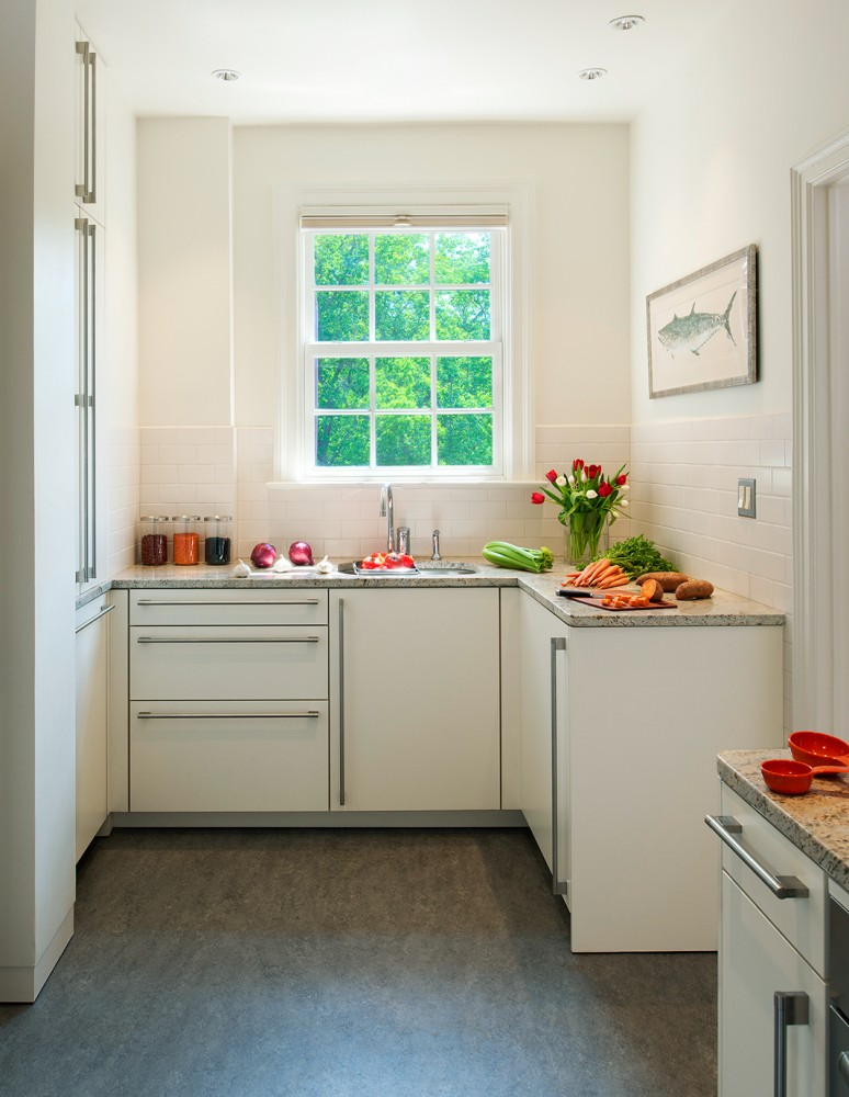 Photo By CARNEMARK Design + Build. Condo Kitchen Renovation