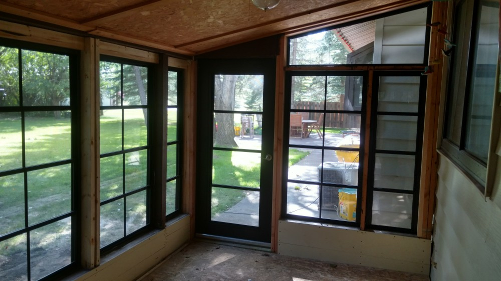 Photo By Souris River Designs & Home Improvement. Sunroom Makeover