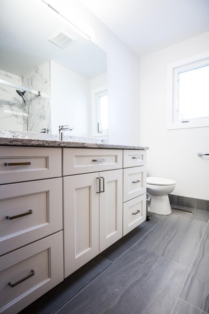 Photo By Peak Improvements LTD. Bathroom Renovation
