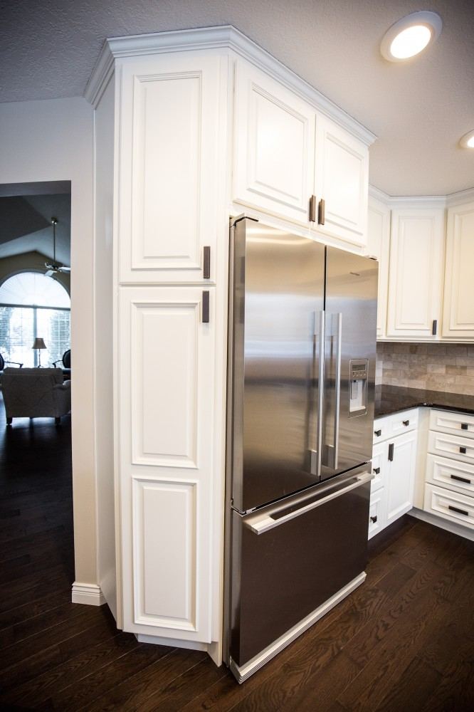 Photo By Peak Improvements LTD. Kitchen Renovation & Reconfiguration