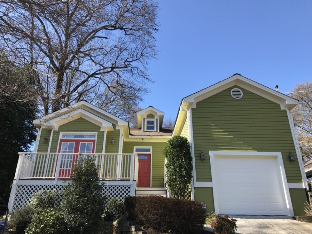 Photo By Nelson Exteriors. Bright Exterior Paint Job