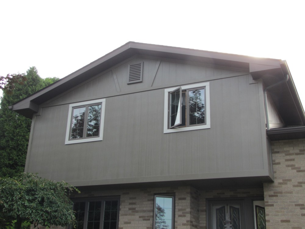 Photo By Legacy Remodeling, INC. Vertical Siding Replacement