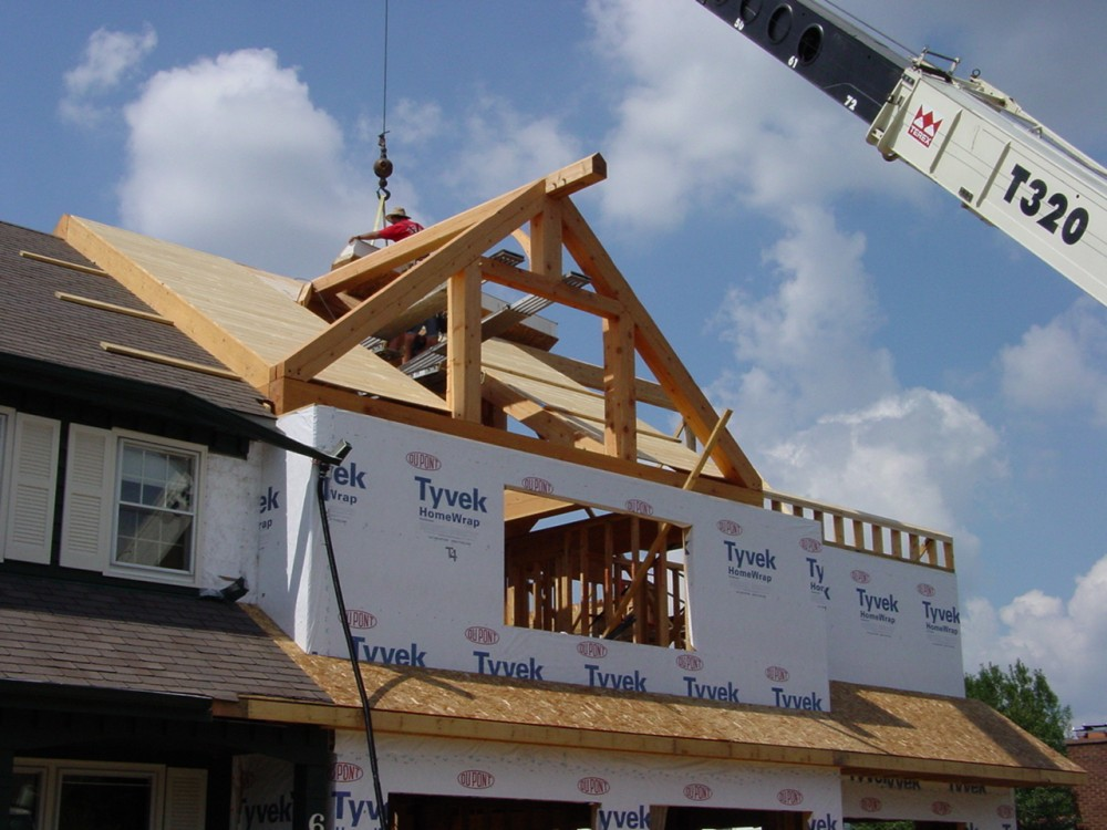 Photo By Crimson Design & Construction. Timber Frame Addition