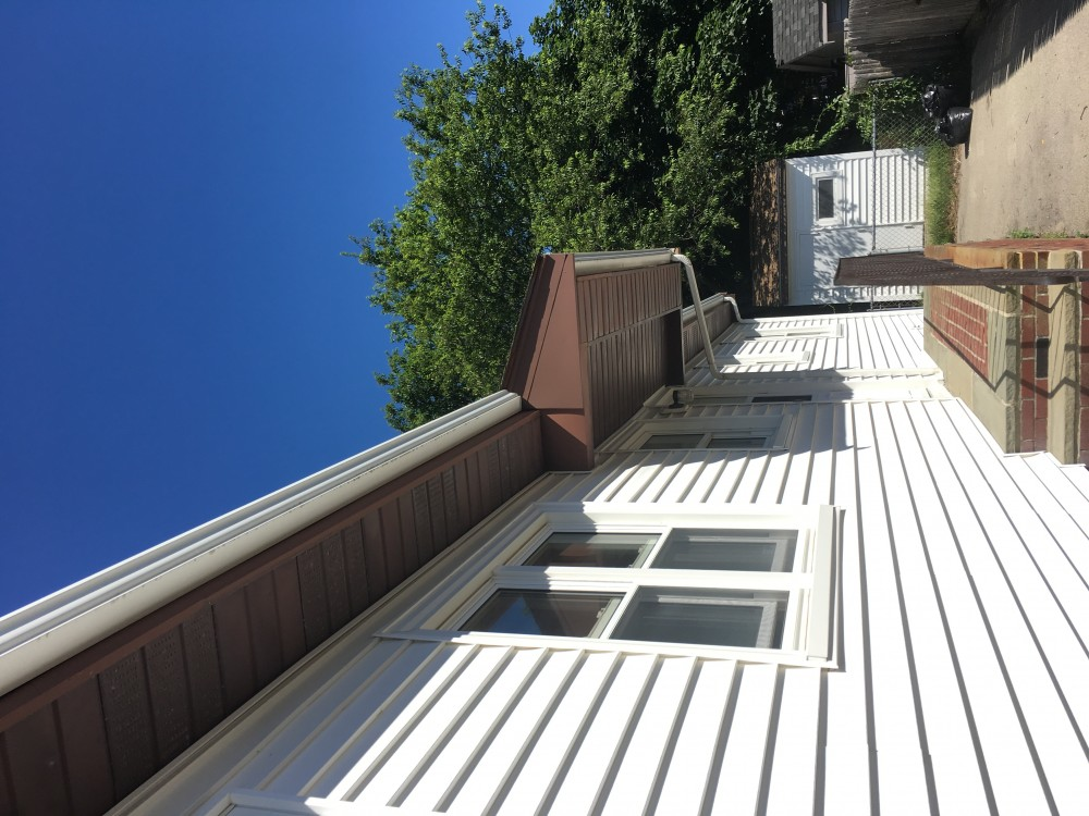 Photo By Beantown Home Improvements. New Trim Wrapped With PVC Trimcoil And New Soffitt