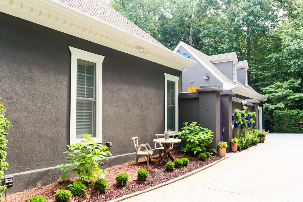 Photo By SuperiorPRO Exteriors. Stucco Painted Grey - With A Pop Of Purple!