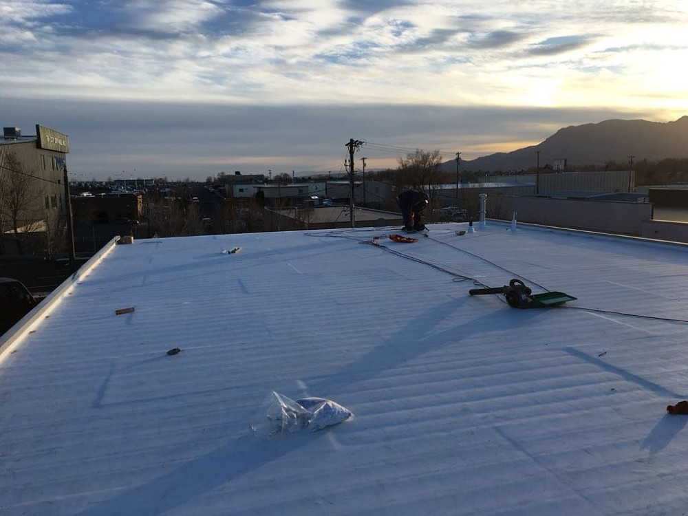 Photo By Divine Roofing, Inc.. Commercial Re-roof