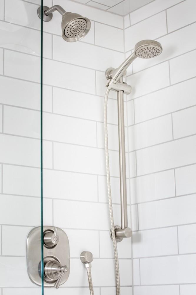 Photo By HC Remodel & Design. Dark And Light Bath