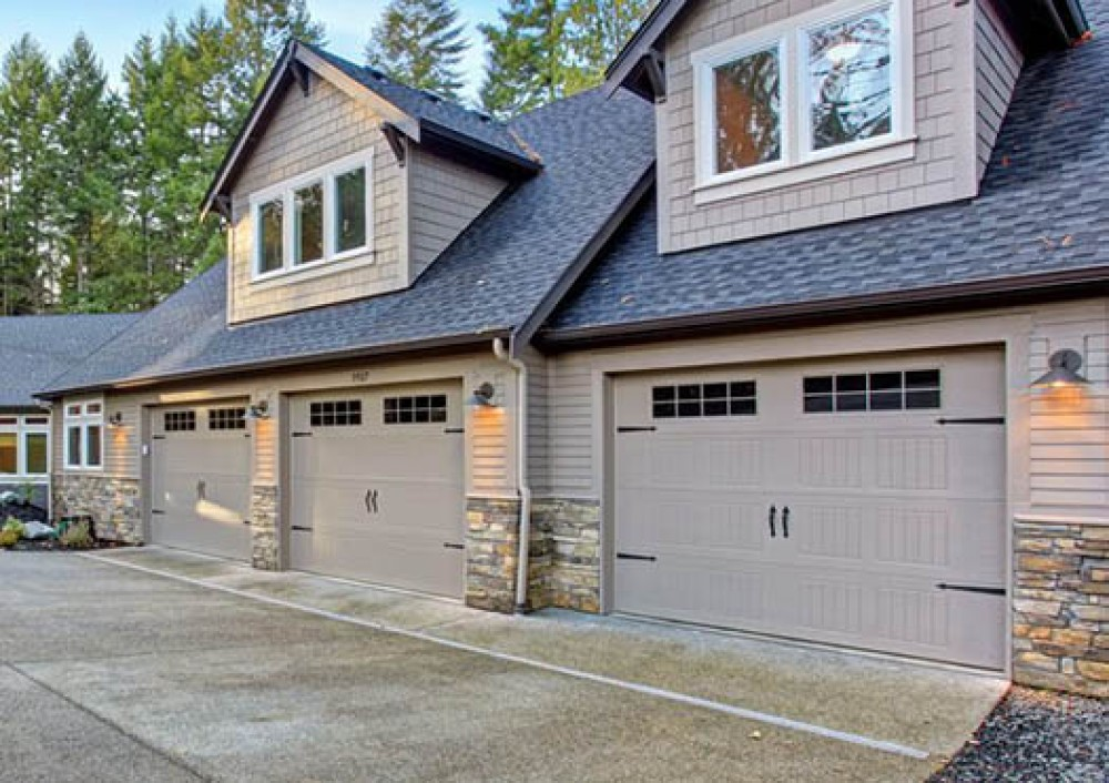 Photo By Unified Window Systems Inc. . Garage Doors