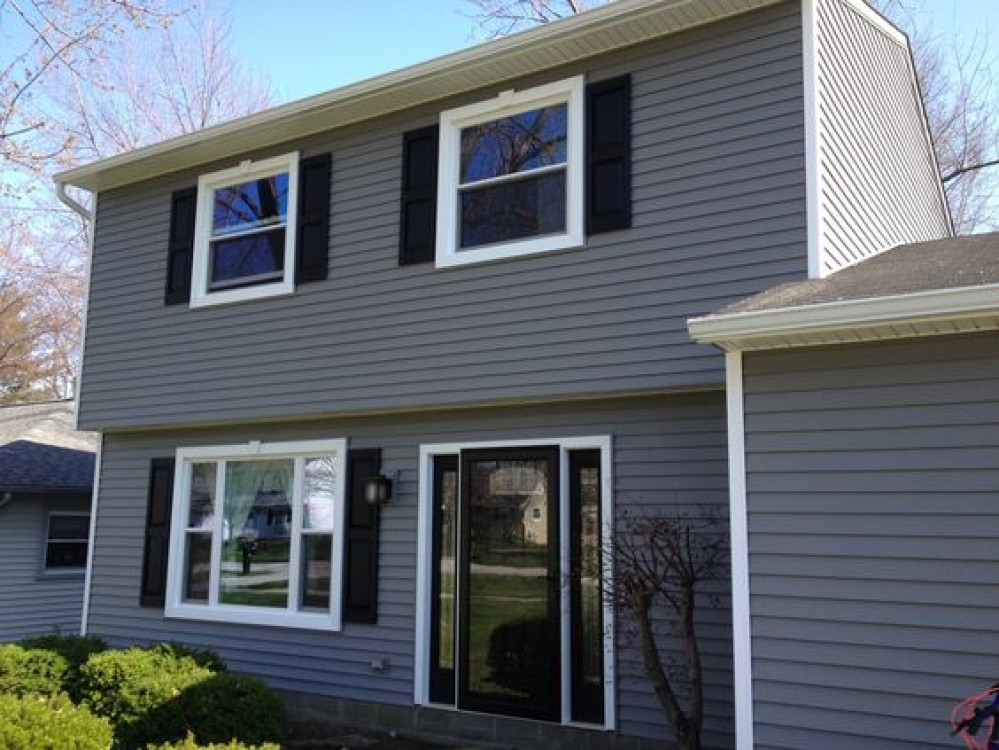 Photo By Unified Window Systems Inc. . Siding