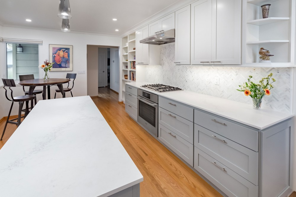 Photo By Talmadge Construction, Inc. Large White Contemporary Kitchen Remodel