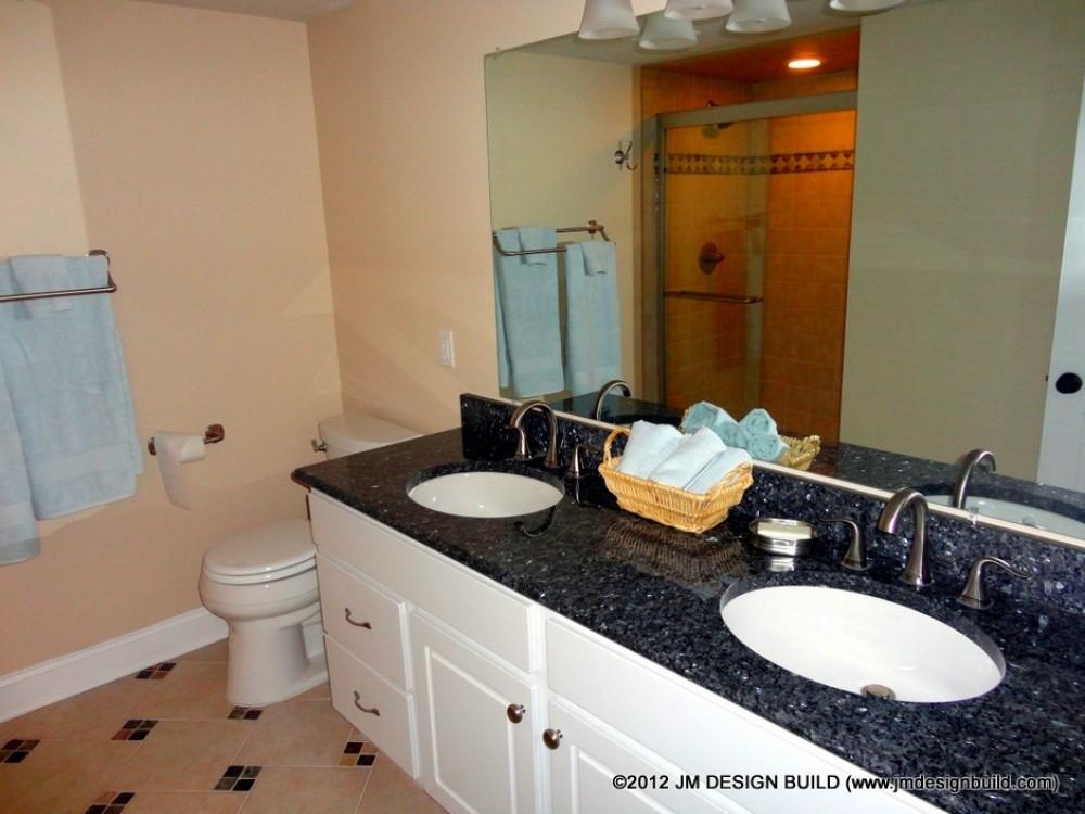Photo By JM Design Build & Remodeling. Basement Finishing Richfield, OH