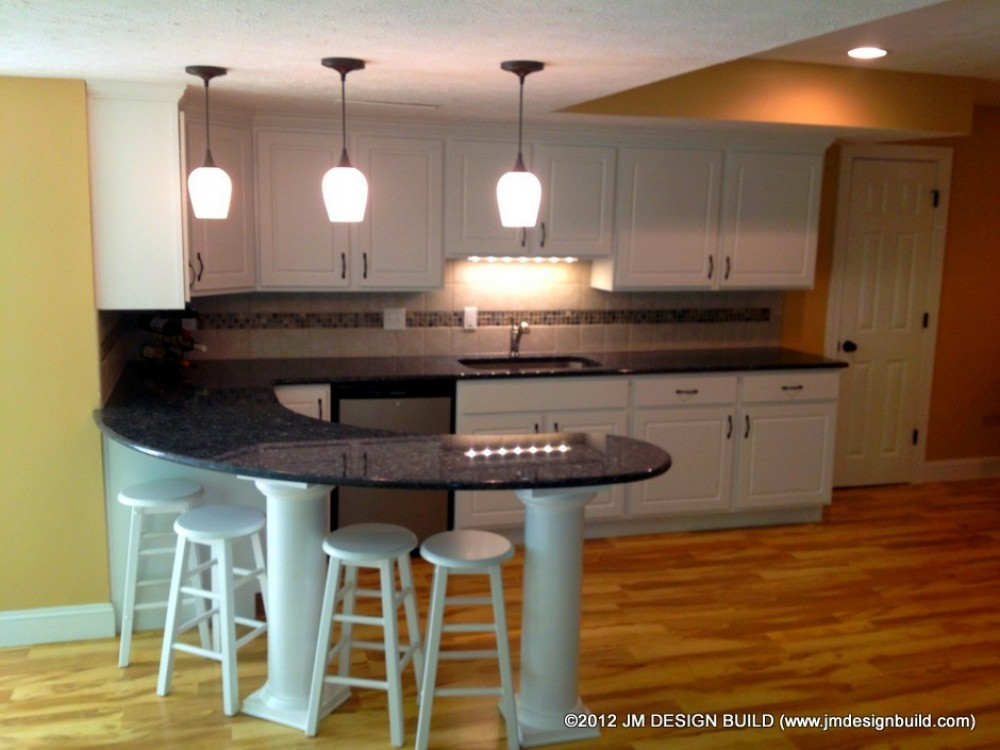Photo By JM Design Build & Remodeling. Basement Finishing Richfield, OH