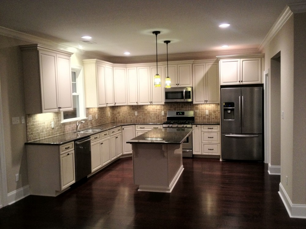 Photo By SYNCON, LLC.. Kitchens