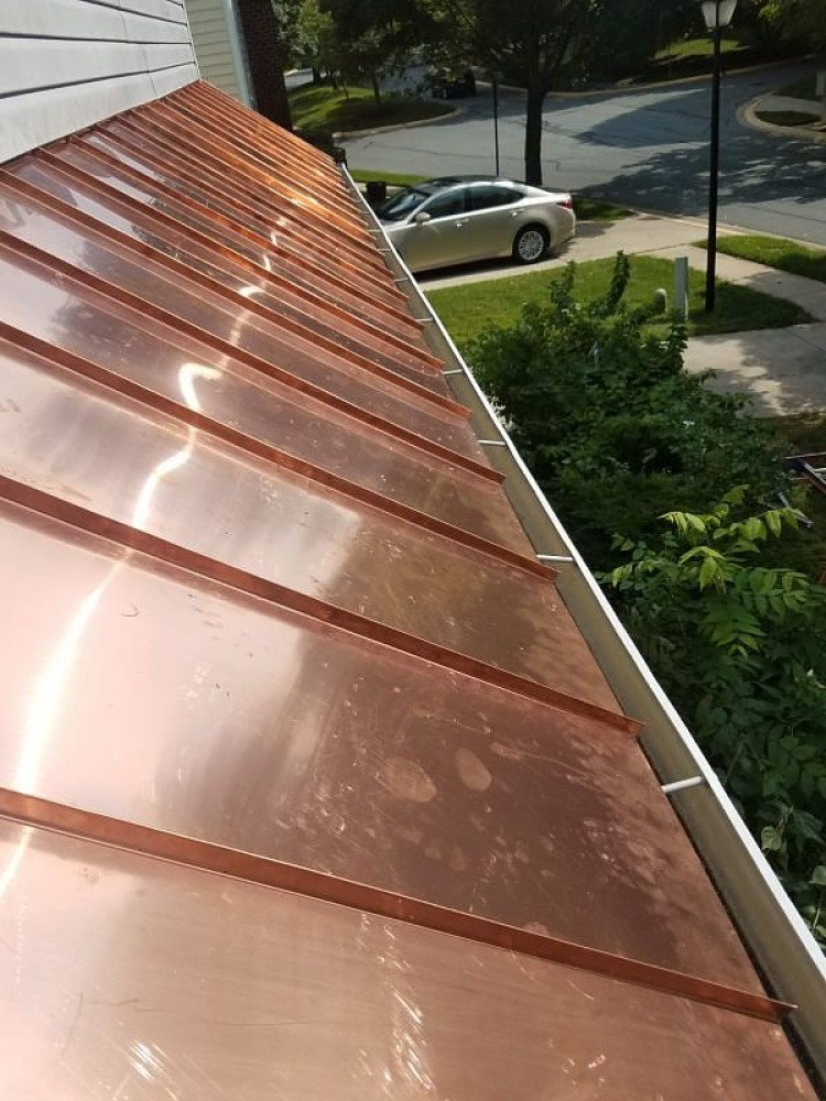 Photo By BRAX Roofing. Copper Standing Seam Roof Replacement