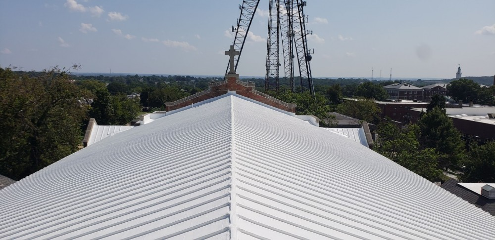Photo By BRAX Roofing. Silicone Roof Coating