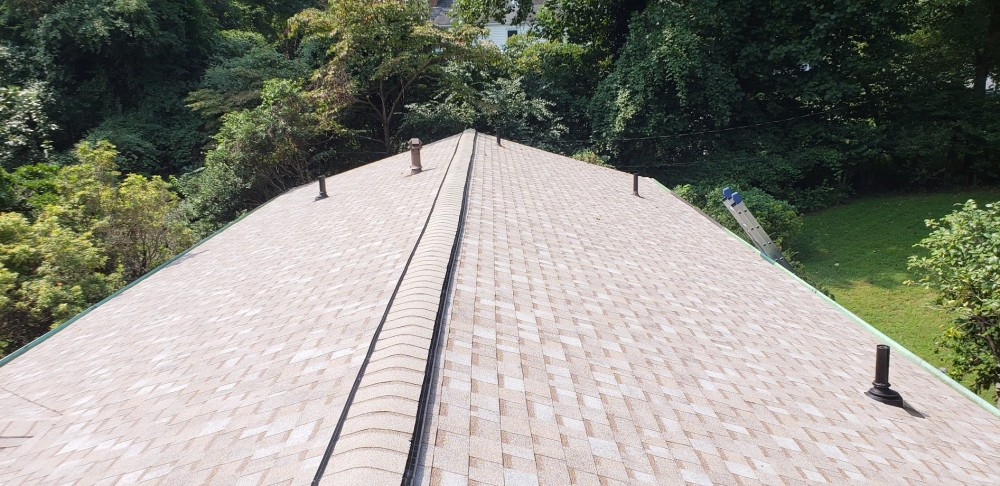 Photo By BRAX Roofing. Installing New Ridge Vents