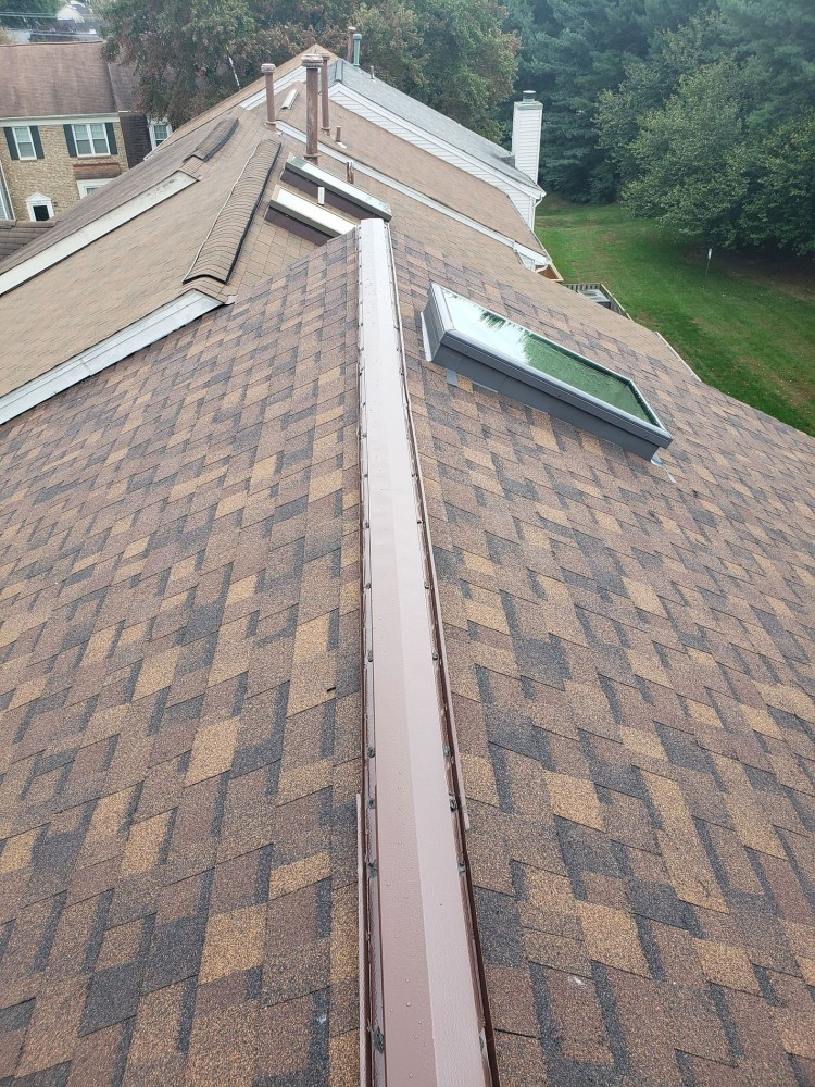Photo By BRAX Roofing. Owens Corning Duration Shingle Roof Replacement With Velux Skylights