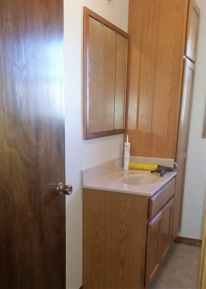 Photo By Wolters Construction. Bathroom Cabinetry & Remodel