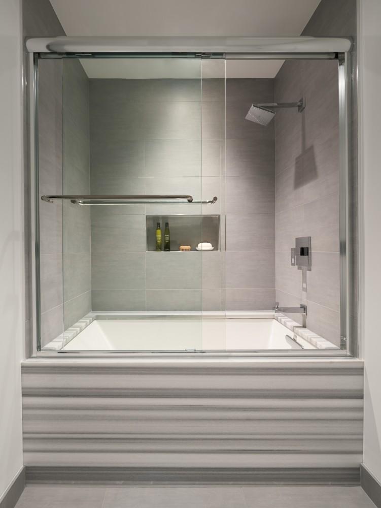 Photo By CARNEMARK Design + Build. STUNNER STRIPES - Bath Remodel