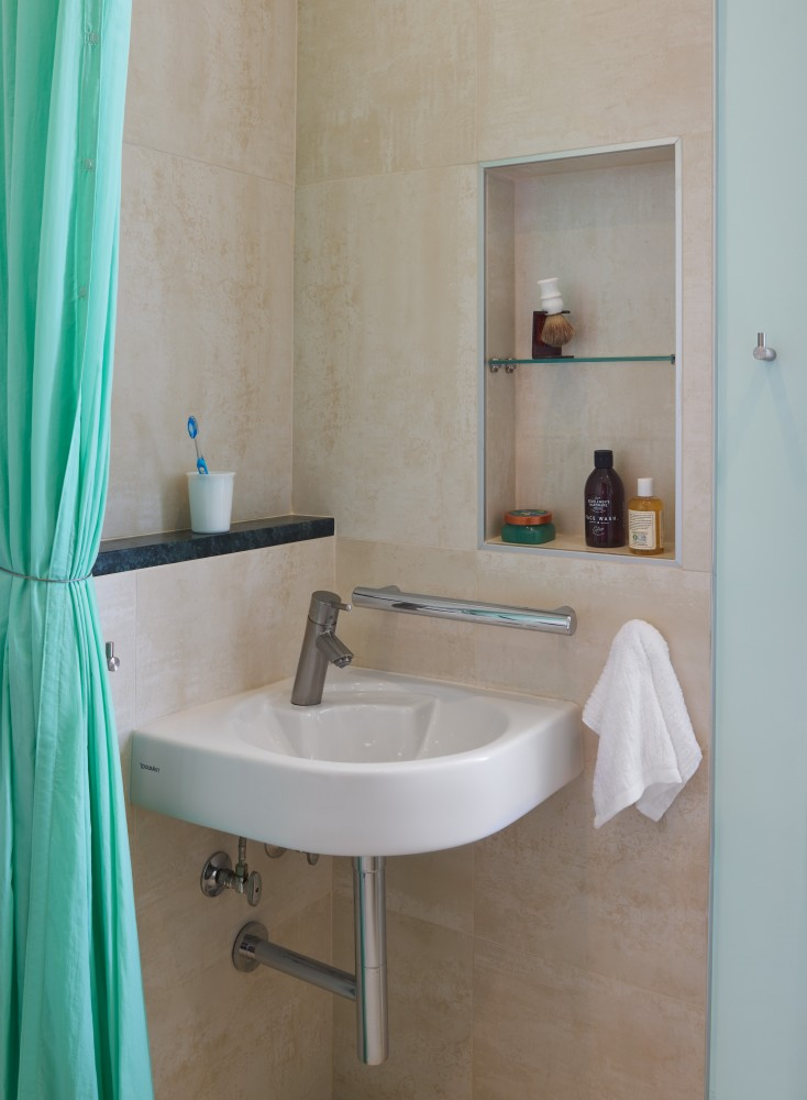 Photo By CARNEMARK Design + Build. ADAPTING WITH AGE - Bath Remodel