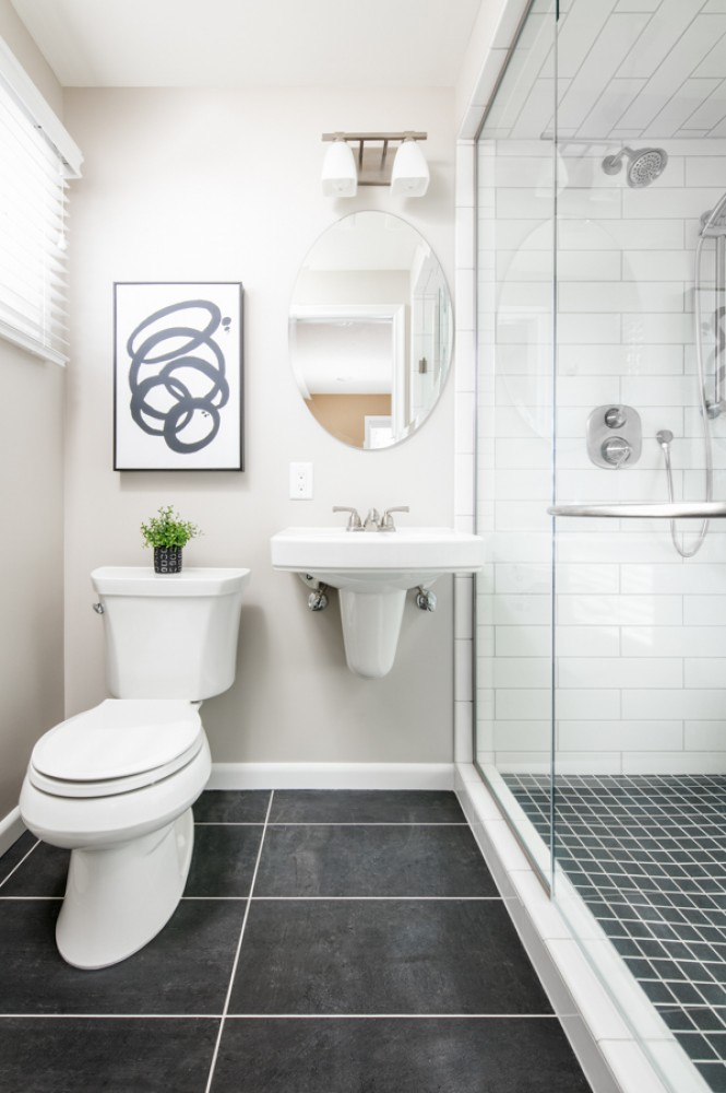Photo By HC Remodel & Design. Black And White Guest Bath Makeover