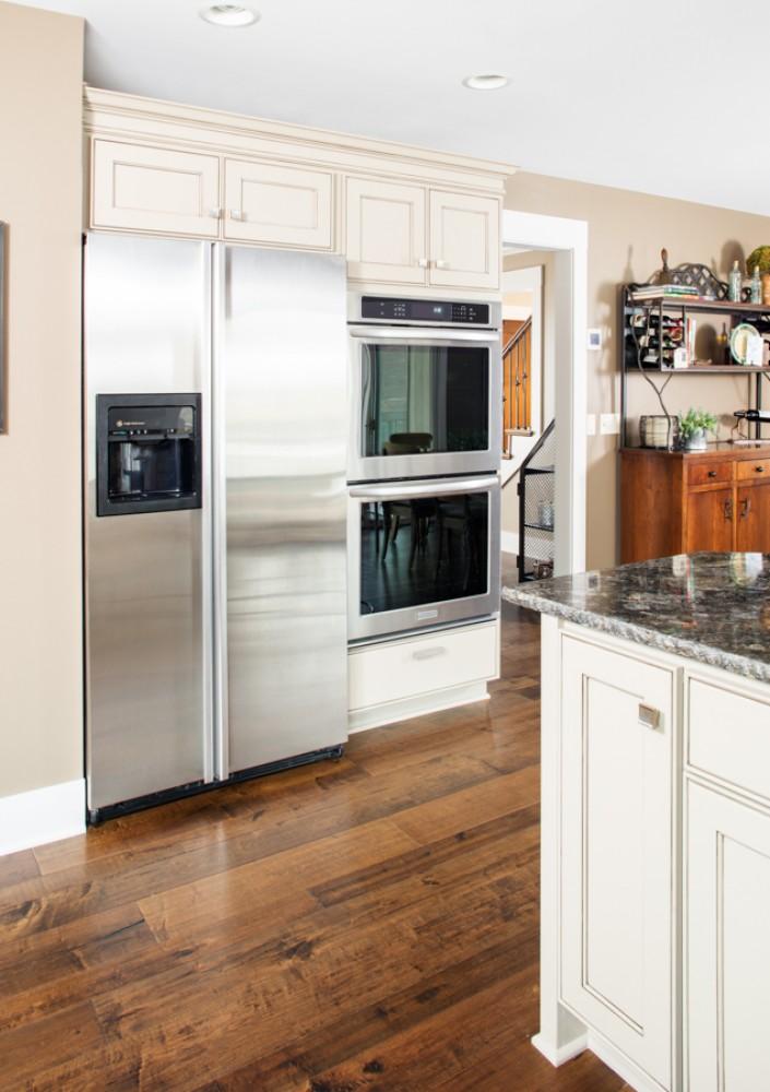 Photo By HC Remodel & Design. Warm Kitchen Facelift