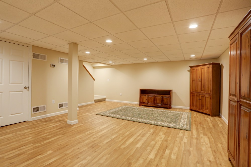Photo By McLennan Contracting Inc.. Finished Basements