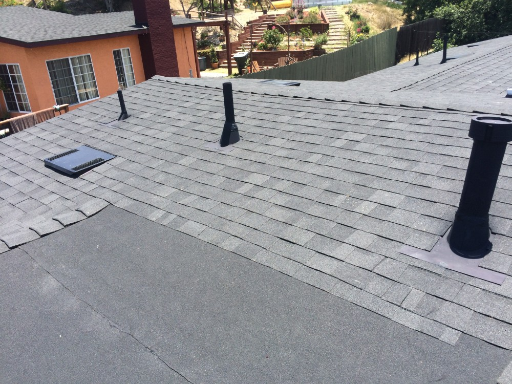 Photo By Elite Roof Services. OC Onyx Black Duration Shingles