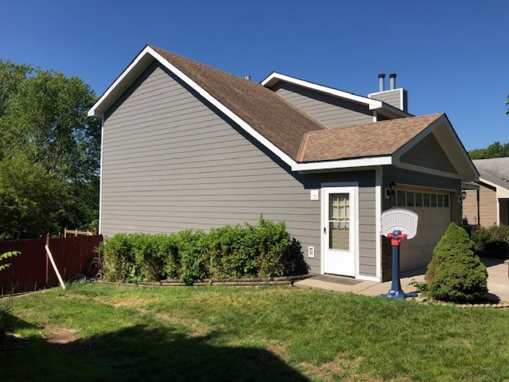 Photo By StateLine Exteriors. James Hardie Siding Aged Pewter And Monterey Taupe Shingles