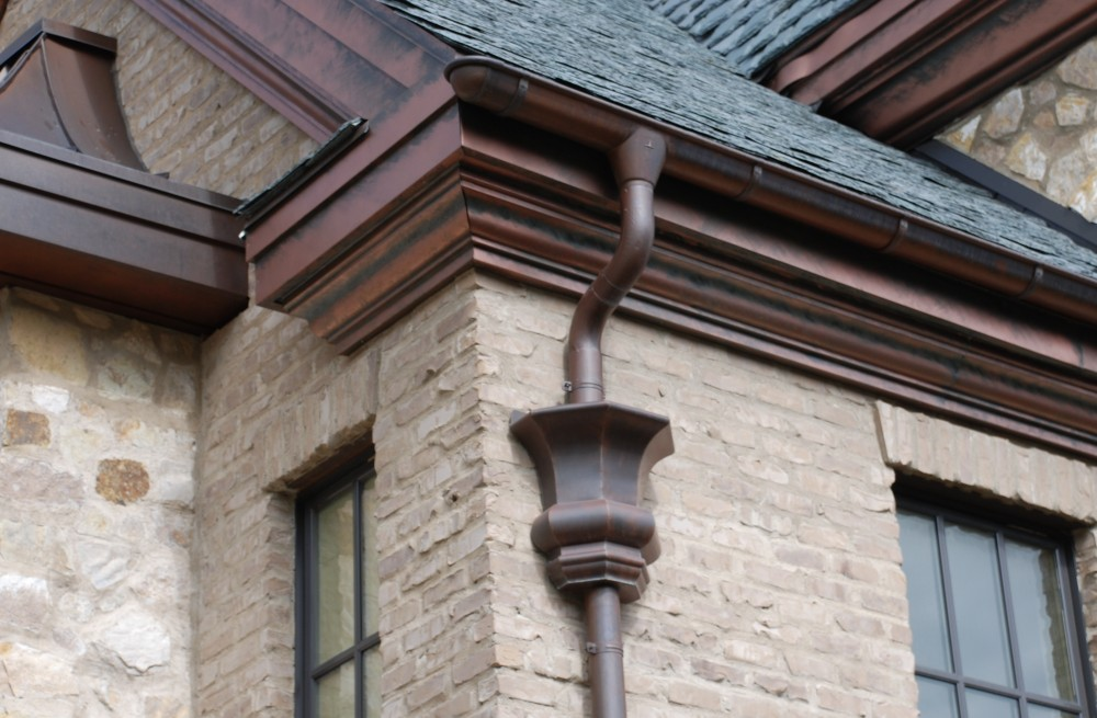 Photo By RGS Exteriors. Custom Copper 1/2 Round