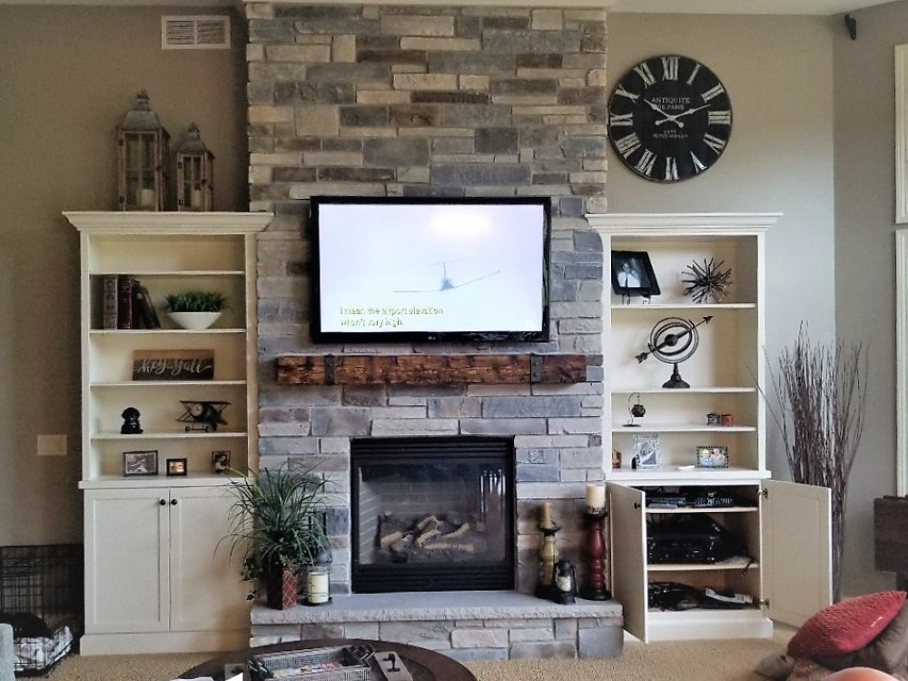 Photo By Russell Room Remodelers. Fireplace