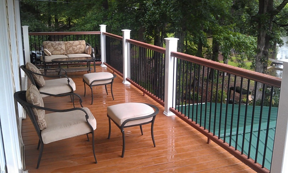 Photo By All American Exteriors. Timbertech Decking, Rails, Stone & Cedar Columns
