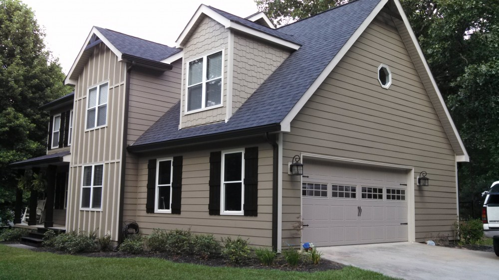 Photo By All American Exteriors. James Hardie Primed Siding