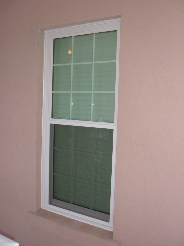 Photo By Siding Industries. HURRICANE IMPACT WINDOWS