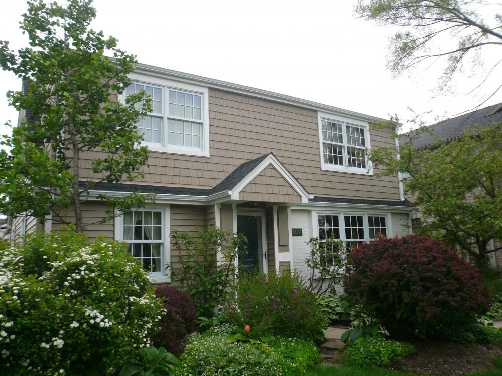 Photo By Mega Home Improvement. Siding & Windows