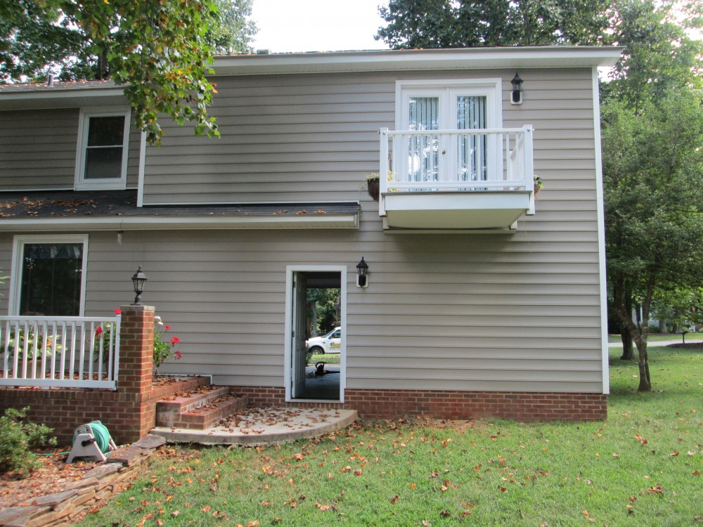 Photo By Kingsford Siding, Windows & Patio Rooms. Patio Room Addition With Additional Garage Storage Room