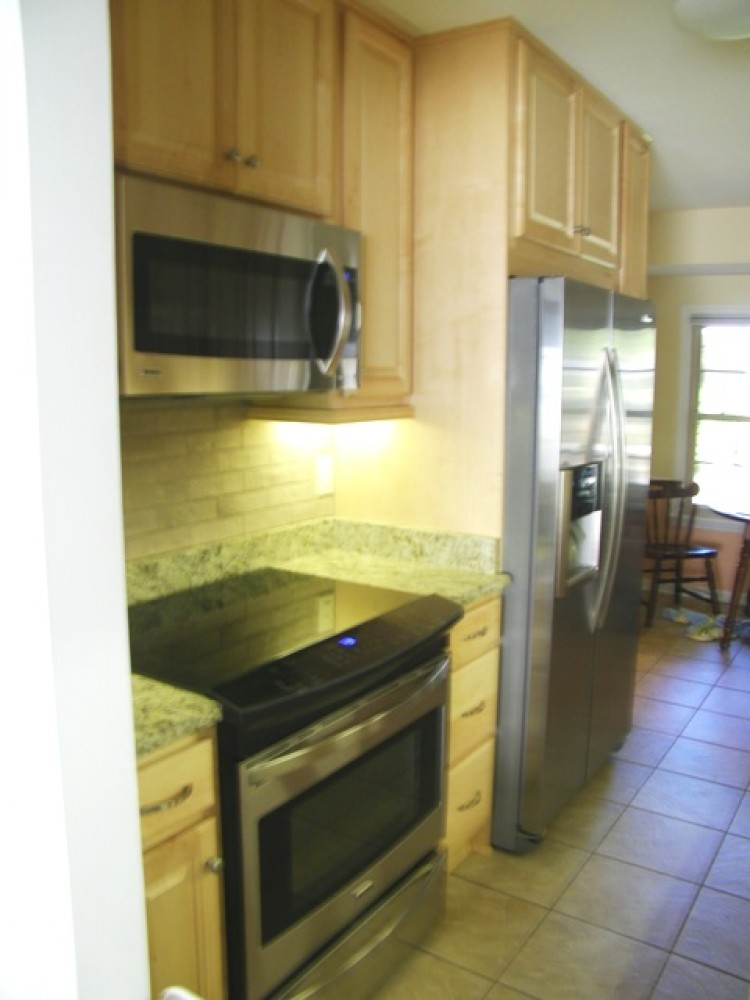 Photo By Welcom Cabinets. Before & After:Kitchen Renovation