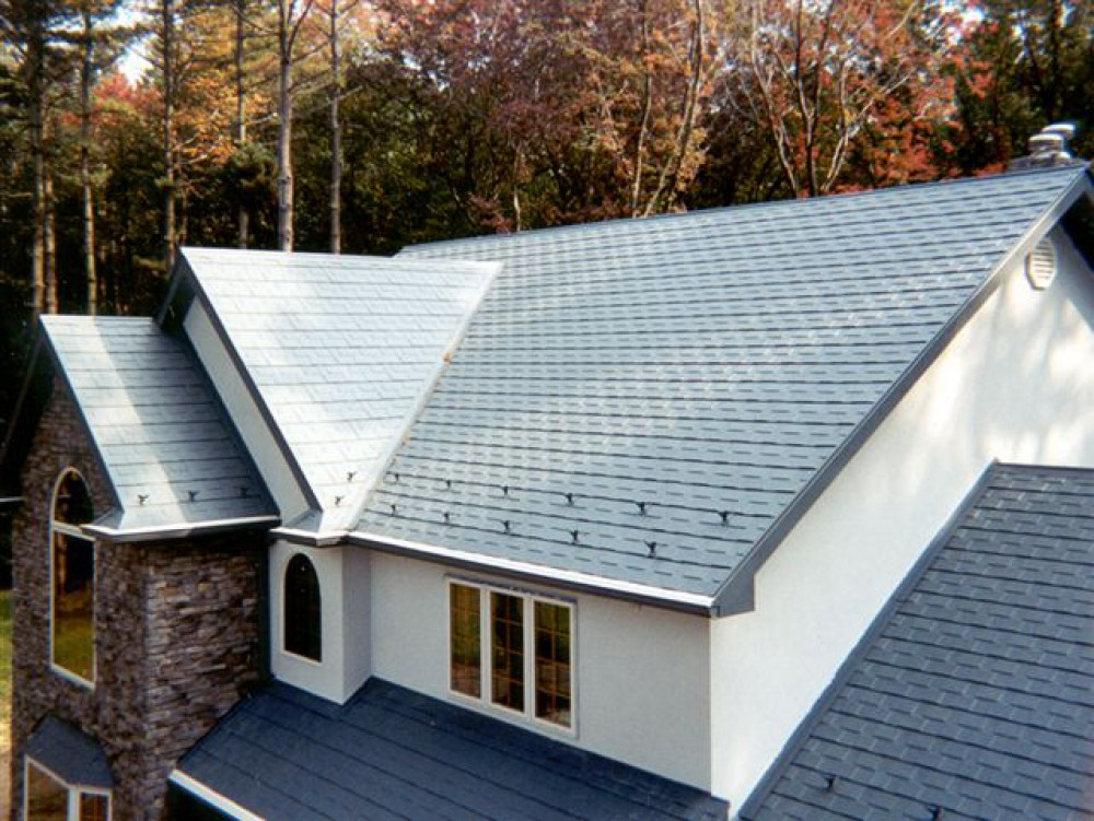Photo By Global Home Improvement. Metal Shingles