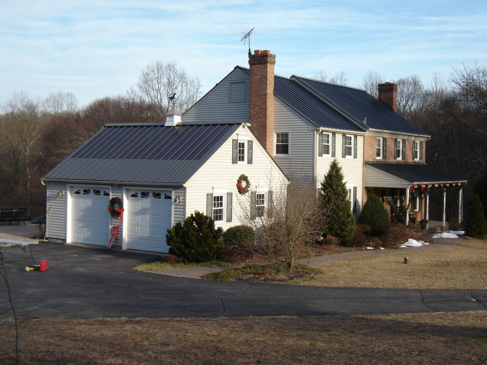 Photo By Global Home Improvement. Metal Solar Roofing