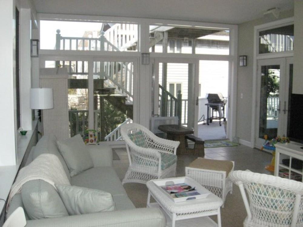 Photo By Boardwalk Builders. Sunroom