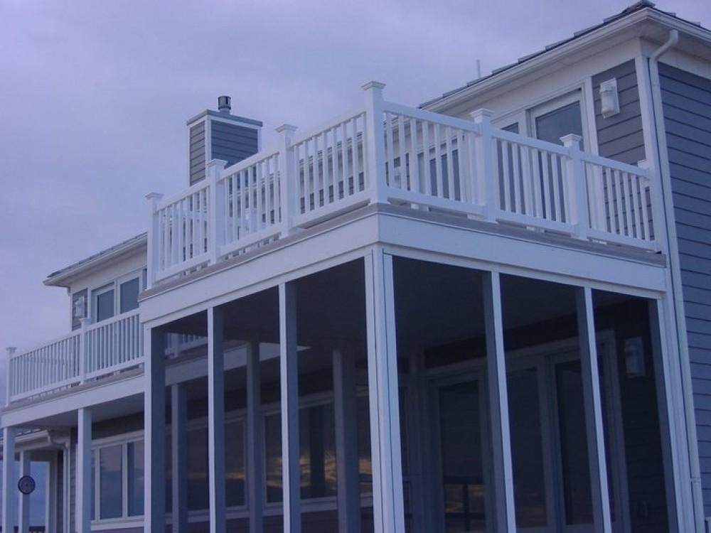 Photo By Boardwalk Builders. Decks & Deck Rails