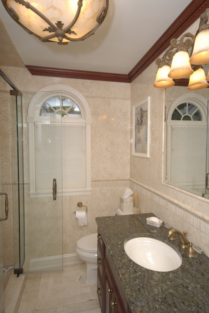 Photo By Kuhn Construction, Inc.. Bathrooms By KCI