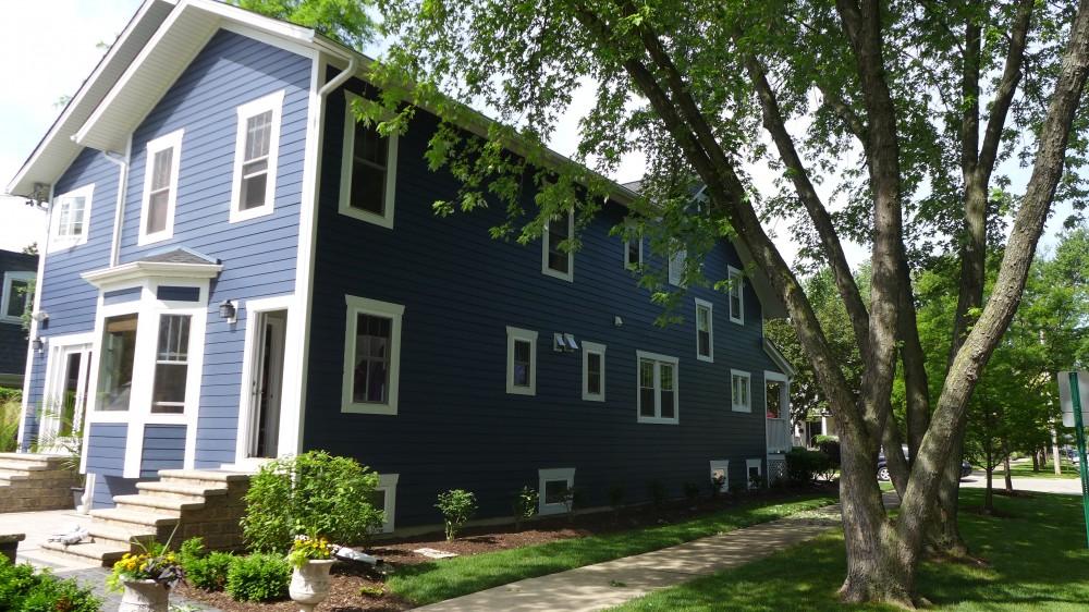 Photo By Erdmann Exterior Designs Ltd.. James Hardie Siding: Park Ridge, IL